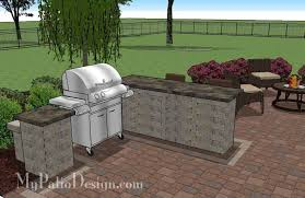 Backyard Brick Patio Design With Grill Station Seating Wall And creative backyard patio design with grill station bar 530 sq ft