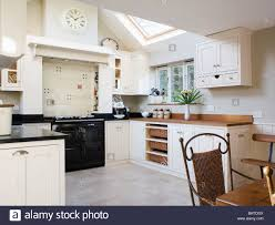 black aga oven in traditional cream kitchen dining room extension