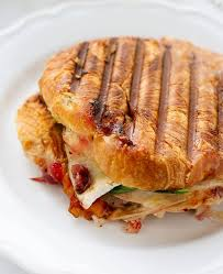turkey croissant panini with brie and cranberry relish striped