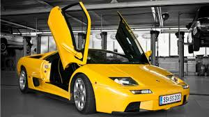 logo lamborghini lamborghini bull yellow car wallpapers 1366x768 366149