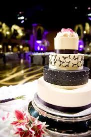 serving wedding guests cake with a chocolate covered straberry