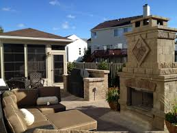 Chicago Patio Design by Tiered Outdoor Fireplace Design Compliments Patio Archadeck