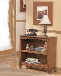 cross island sofa table cross island medium brown small bookcase h319 15 bookcases