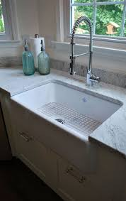 kitchen stainless steel faucet with hand sprayer and granite