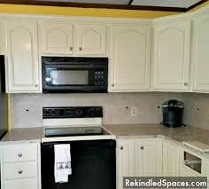 Tips For Painting Kitchen Cabinets Easy Painting Project For Your Kitchen Cabinets Dark Cabinets To