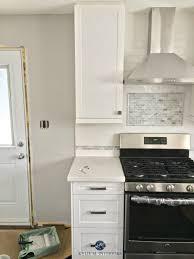 home depot glass backsplash tile grey maple cabinets clearance
