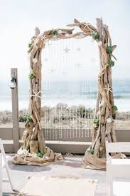 wedding arches in edmonton rustic wood wedding arch with burlap and white starfish