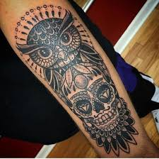 Owl Tattoos - black ink traditional owl with sugar skull on right sleeve