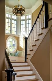 High Window Seat - airy staircase with readingnook addition interior design