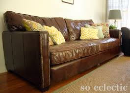 leather sofa with nailheads new sofa a love story u2014 soeclectic