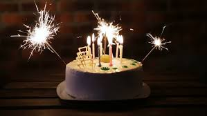 birthday cake sparklers cake birthday party in a room with lots of candles and