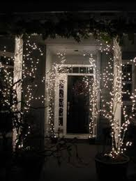 Christmas Lights For Stair Banisters Tied Stocking U0027s To Railings With Ribbon Hung Ornaments On Antique