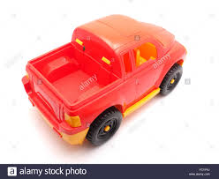red toy jeep red toy car on a white background stock photo royalty free image