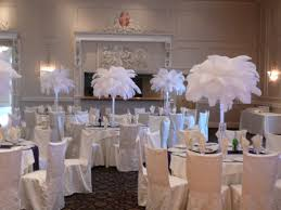 ostrich feather centerpieces these will be the centerpieces except clear vases with black