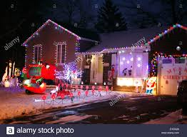 a canadian house lavishly decorated with christmas lights on the