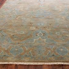katrina oushak rug in aqua sand and butter cream shades of light