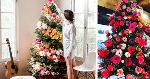 decorating christmas tree are decorating their christmas trees with flowers and the