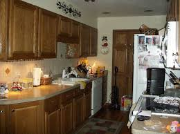 what color should cabinets be in a small kitchen paint color for small galley kitchen oak cabinets flooring