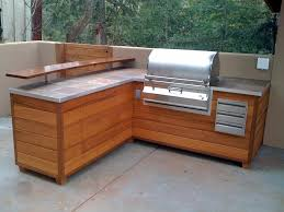 bbq outdoor kitchen islands an outdoor barbeque island that looks like wooden furniture