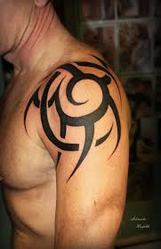 aries tribal tattoo on shoulder