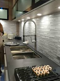 bathroom corian countertop with kraus sinks and blanco faucets