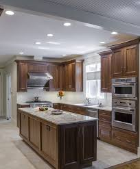 elmwood kitchen cabinets elmwood cabinetry walnut cabinets ge appliances stainless steel