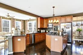 love this kitchen with floating island breakfast bar candelabra