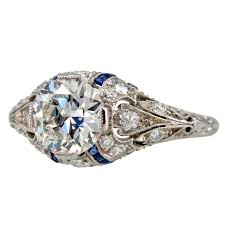 engagement ring with 1 24ct diamond with sapphire accents for sale