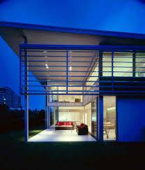 modern minimalist design of the pole barn house that has modern