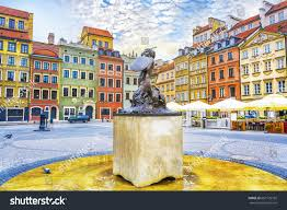 fountain mermaid colorful houses on old stock photo 667129792