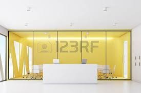 Yellow Reception Desk Corner View Of A Reception Desk Standing In An Office Corridor