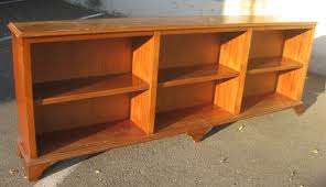 classic lacquered oak wood low bookcase which equipped with two