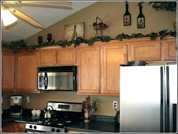 decorating ideas for kitchen cabinet tops how to decorate cabinet tops decorating ideas kitchen cabinet tops