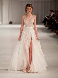 rent a wedding gown renting wedding dresses play image may contain 1 person standing