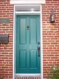 teal painted front door with red bricks the first thing about