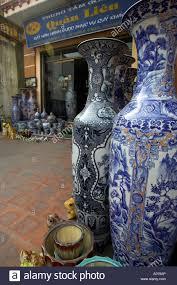 tall oriental design vases outside shop ceramic village bat trang