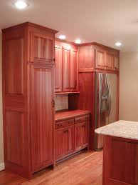 sumptuous built in mahogany cabinets with beige wall painted as