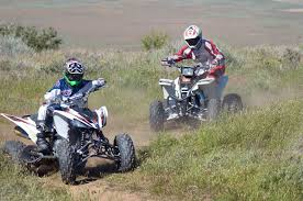 dirt wheels magazine shoot out yamaha blaster vs raptor