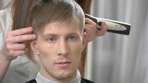 female haircutting videos clipper caucasian man getting haircut female hand hair clipper stock