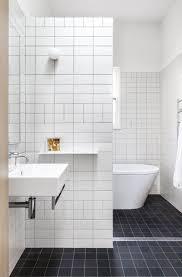 white tile bathroom ideas white tile bathroom and flooring with black ceramic inside small