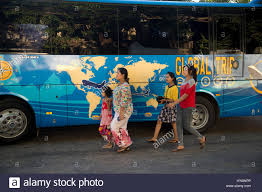 myanmar burma mawlamyine tour bus painted with a map of the