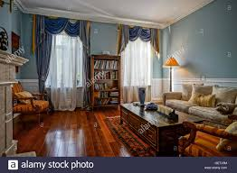 russian interior design beautiful living room interior with high windows old styled