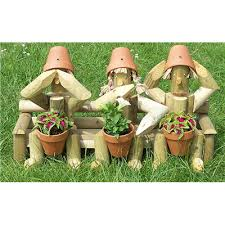 wooden garden flowerpot three wiseguys a great garden ornament