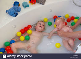 children in the bath tub stock photo royalty free image