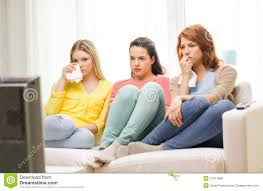 three sad teenage watching tv at home stock photo image