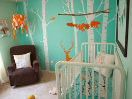 baby themes for a boy soft blue wall with white tree paint combined by white wooden