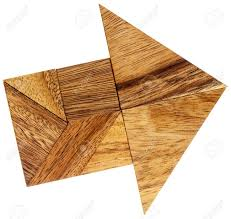abstract picture of an arrow built from seven tangram wooden