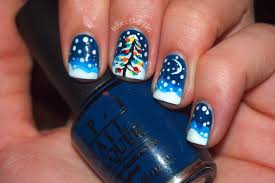 falling snow and pine tree motif nail art designs blue and white