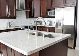 kashmir white granite with cherry color cabinets kitchen