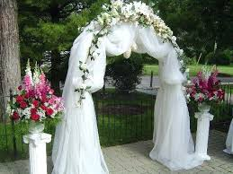 wedding arches using tulle wedding arch decorated with tulle and flowers joshuagray co